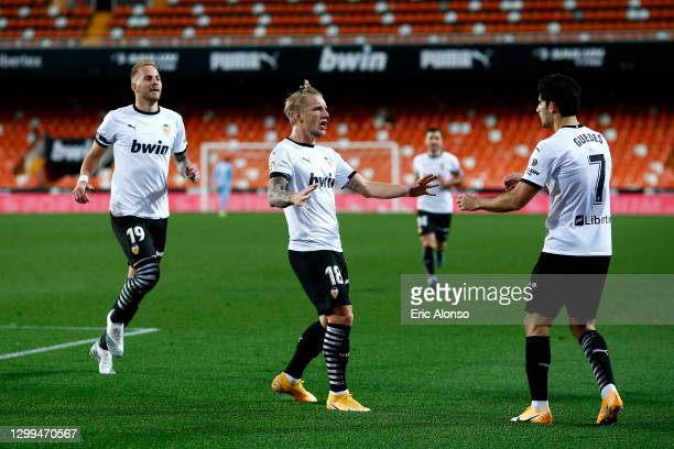 Daniel Wass of Valencia celebrates with Goncalo Guedes after scoring their team's first goal during the La Liga Santander match between Valencia CF...