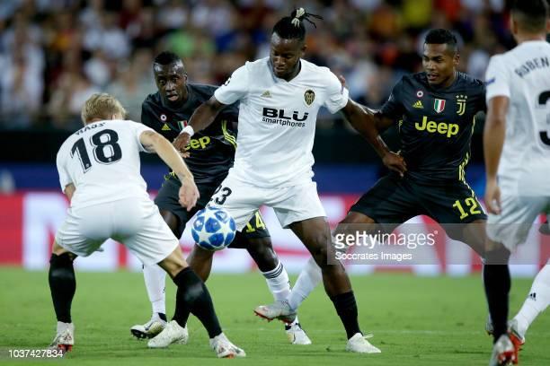 Daniel Wass of Valencia CF Blaise Matuidi of Juventus Michy Batshuayi of Valencia CF Alex Sandro of Juventus during the UEFA Champions League match...