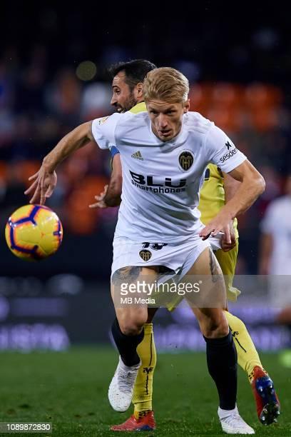 Daniel Wass of Valencia CF competes for the ball with Mario Gaspar of Villarreal CF during the La Liga match between Valencia CF and Villarreal CF at...