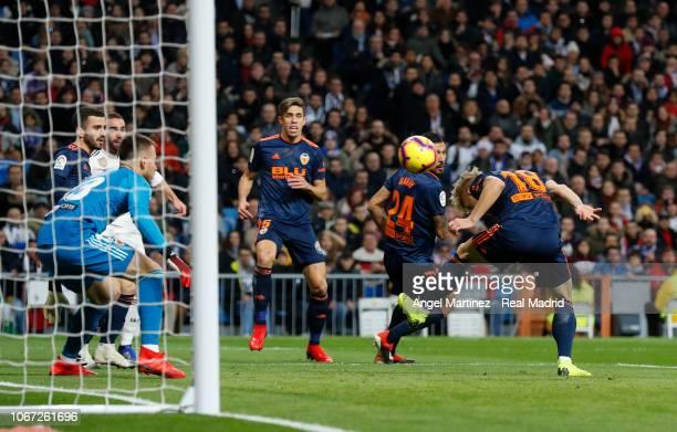 Daniel Wass of Valencia scores an own goal during the La Liga match between Real Madrid CF and Valencia CF at Estadio Santiago Bernabeu on December 1...