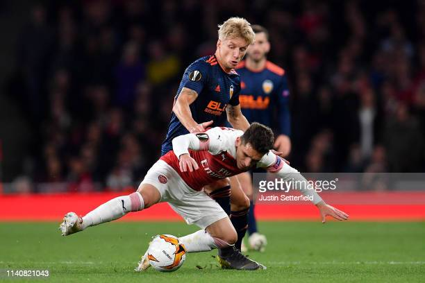 Daniel Wass of Valencia tackles Lucas Torreira of Arsenal during the UEFA Europa League Semi Final First Leg match between Arsenal and Valencia at...