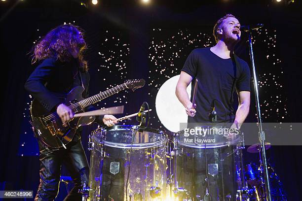 Daniel Wayne Sermon and Dan Reynolds of Imagine Dragons perform on stage during Deck The Hall Ball hosted by 1077 The End at KeyArena on December 9...