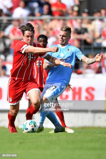 Daniel Wein of 1860 Muenchen and Adrian Fein of Bayern Meunchen compete for the ball during the Regionalliga Bayern match between FC Bayern Muenchen...