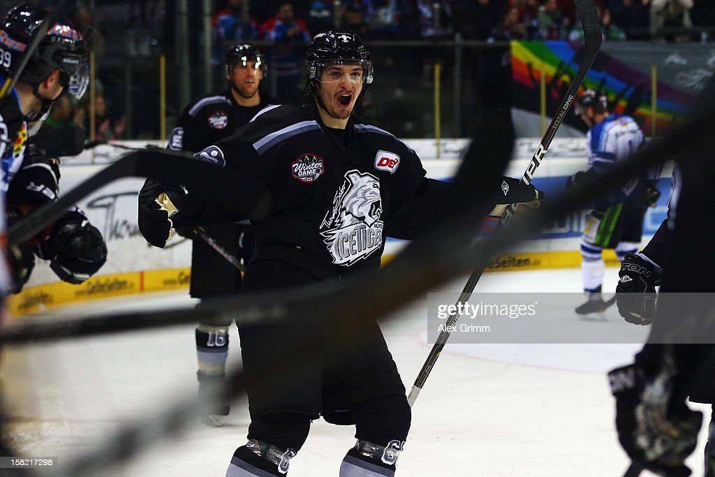 Daniel Weiss of Ice Tigers celebrates his team's fourth goal during the DEL match between Thomas Sabo Ice Tigers and Straubing Tigers at Arena Nuernberger Versicherung on December 11, 2012 in Nuremberg, Germany.