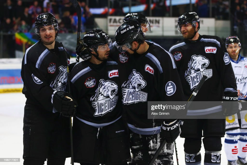 Daniel Weiss (L) of Ice Tigers celebrates his team's fourth goal with team mates during the DEL match between Thomas Sabo Ice Tigers and Straubing Tigers at Arena Nuernberger Versicherung on December 11, 2012 in Nuremberg, Germany.