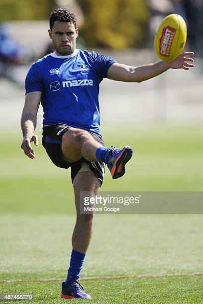 Daniel Wells is seen kicking the ball in his fitness test midway through a North Melbourne Kangaroos AFL training session at Arden Street Ground on...