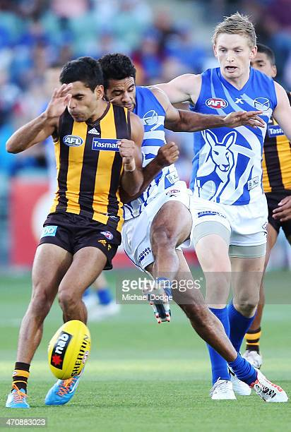Daniel Wells of the Kangaroos is hit in the head by Derek Wanganeen of the Hawks during the round two AFL NAB Challenge match between the Hawthorn...