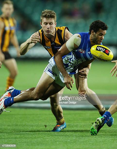 Daniel Wells of the Kangaroos is tackled by Liam Sheils of the Hawks during the round two AFL NAB Challenge match between the Hawthorn Hawks and the...