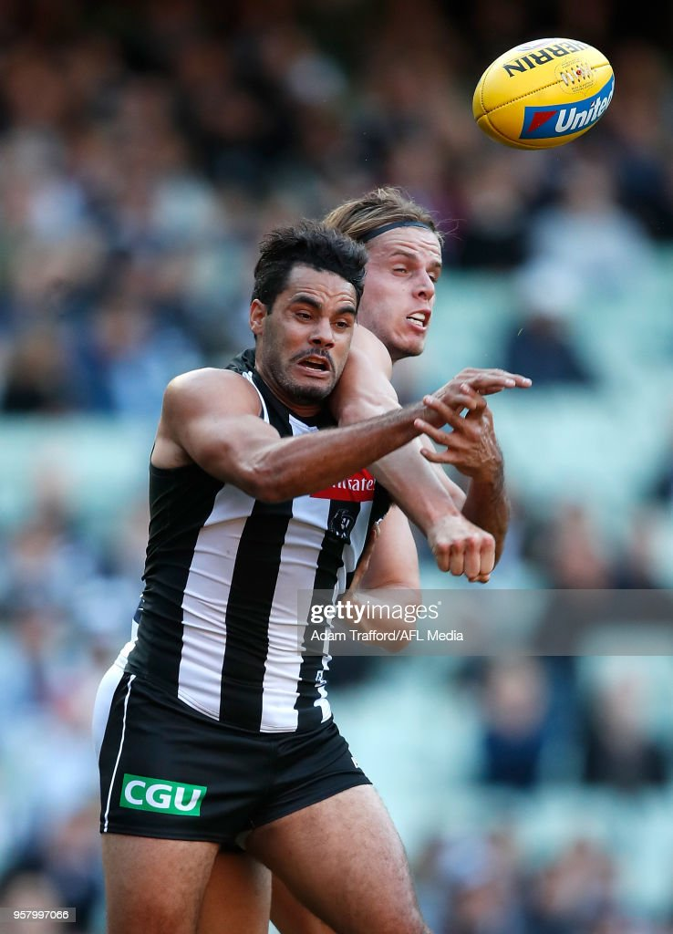 Daniel Wells of the Magpies and Jake Kolodjashnij of the Cats compete for the ball during the 2018 AFL round eight match between the Collingwood Magpies and the Geelong Cats at the Melbourne Cricket Ground on May 13, 2018 in Melbourne, Australia.