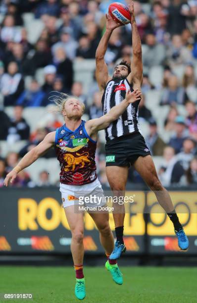 Daniel Wells of the Magpies marks the ball against Daniel Rich of the Lions during the round 10 AFL match between the Collingwood Magpies and...