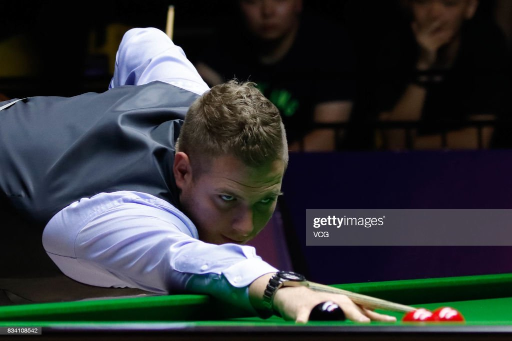 Daniel Wells of Wales plays a shot during his first round match against Judd Trump of England on day two of Evergrande 2017 World Snooker China Champion at Guangzhou Sport University on August 17, 2017 in Guangzhou, Guangdong Province of China.