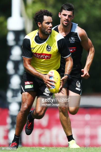Daniel Wells runs clear with the ball of Scott Pendlebury during a Collingwood Magpies AFL training session on January 29 2018 in Melbourne Australia