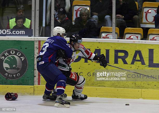 Daniel Welser of Austria vies with Simon Bachelet of France during the Olympia Qualification Game AustriaFrance 11 February 2005 in Klagenfurt Austria