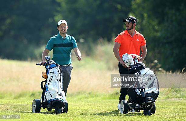 Daniel Wilkes of Garforth GC and partner Paul O'Donnell of Cookridge Hall GC chats during day one of the PGA Fourball Championship at Carden Park on...