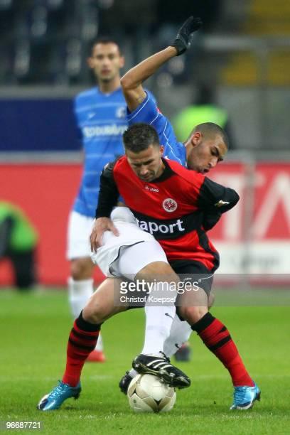 Daniel Williams of Freiburg and Benjamin Koehler of Frankfurt battle for the ball during the Bundesliga match between Eintracht Frankfurt and SC...
