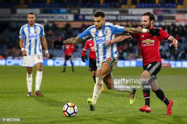 Daniel Williams of Huddersfield Town and Juan Mata of Manchester United during the Emirates FA Cup Fifth Round match at The John Smiths Stadium on...