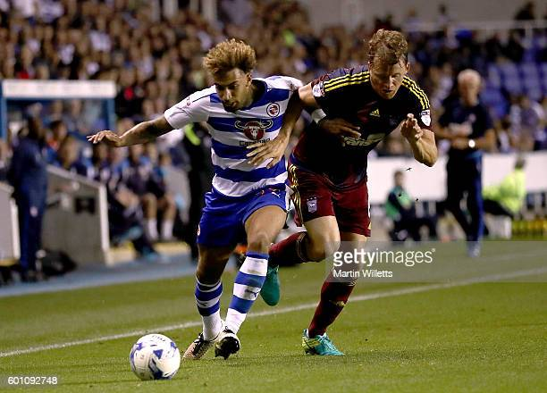 Daniel Williams of Reading and Christope Berra of Ipswich Town battle for the ball during the Sky Bet Championship match between Reading and Ipswich...