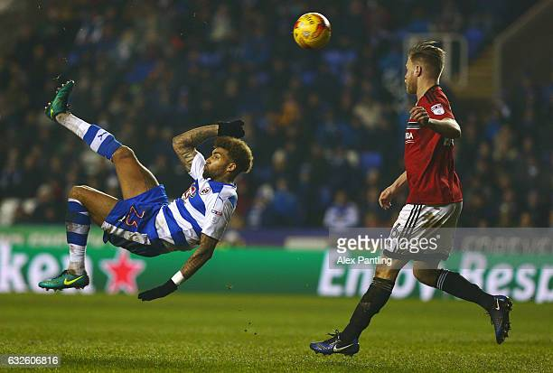Daniel Williams of Reading attempts an overhead kick as Tomas Kalas of Fulham moves in during the Sky Bet Championship match between Reading and...