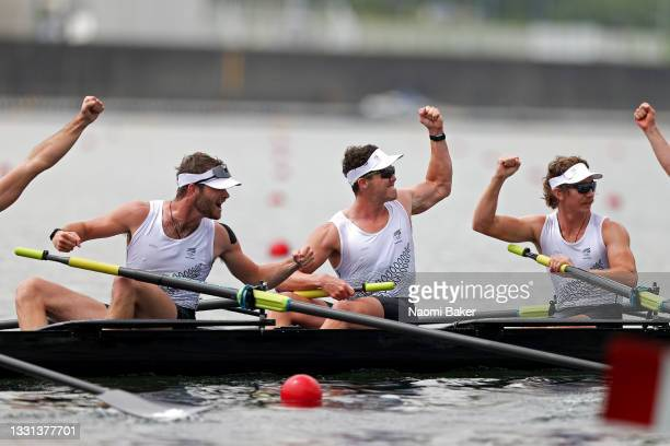 Daniel Williamson, Michael Brake and Tom Murray of Team New Zealand celebrate winning the gold medal during the Men's Eight Final A on day seven of...