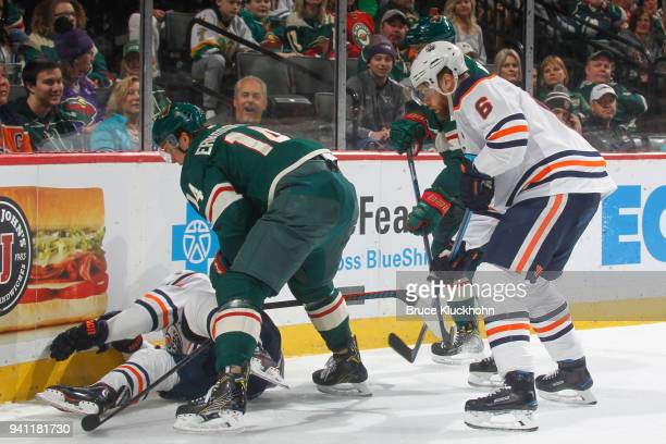 Daniel Winnik and Joel Eriksson Ek of the Minnesota Wild battle for the puck with Adam Larsson and Michael Cammalleri of the Edmonton Oilers during...
