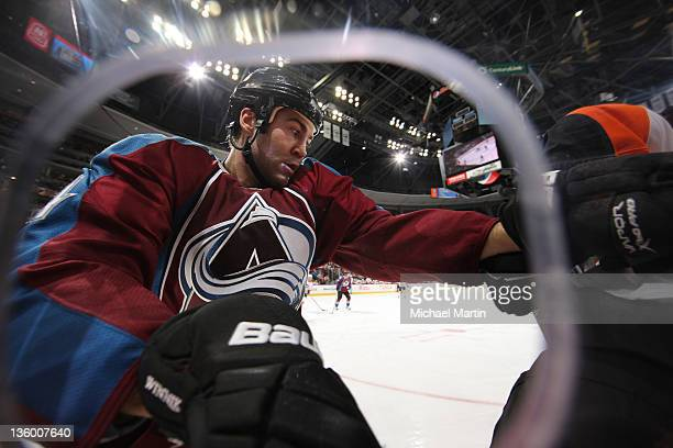 Daniel Winnik of the Colorado Avalanche shown through a hole in the glass skates against the Philadelphia Flyers at the Pepsi Center on December 19...