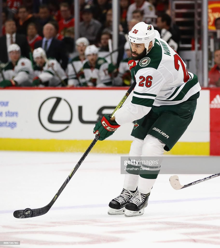 Daniel Winnik #26 of the Minnesota Wild controls the puck against the Chicago Blackhawks at the United Center on October 12, 2017 in Chicago, Illinois. The Wild defeated the Blackhawks 5-2.