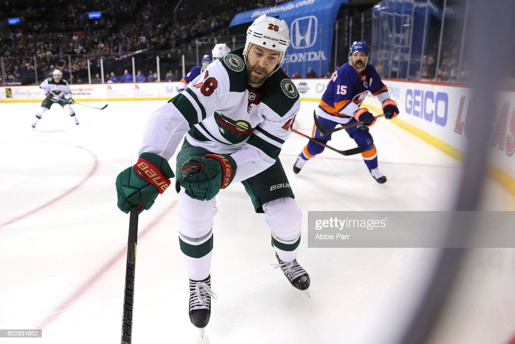 Daniel Winnik #26 of the Minnesota Wild skates for the puck in the first period against the New York Islanders during their game at Barclays Center on February 19, 2018 in the Brooklyn borough of New York City.