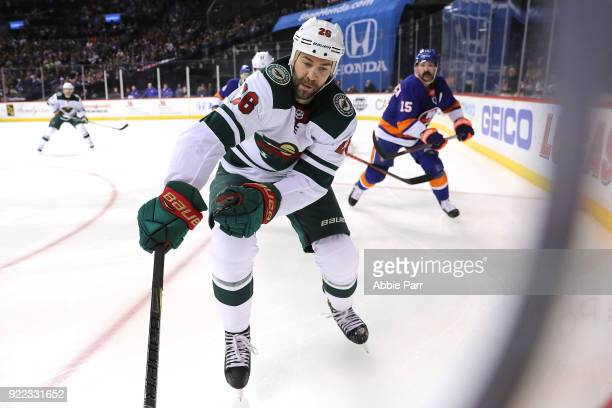 Daniel Winnik of the Minnesota Wild skates for the puck in the first period against the New York Islanders during their game at Barclays Center on...