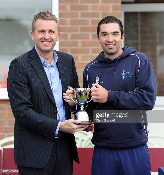 Daniel Woods of York is presented with the Kingfisher Beer Cup by Dominic Cork following the Kingfisher Beer Cup Final between York and Wanstead...