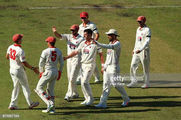 Daniel Worrall of South Australia celebrates with team mates after dismissing Jhye Richardson of Western Australia during day three of the Sheffield...