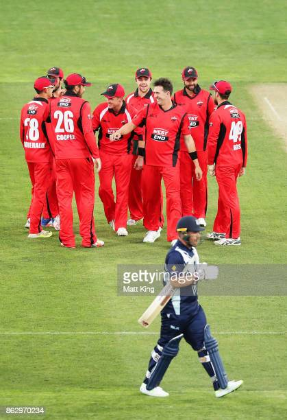 Daniel Worrall of the Redbacks celebrates with team mates after taking the first wicket of Aaron Finch of the Bushrangers during the JLT One Day Cup...