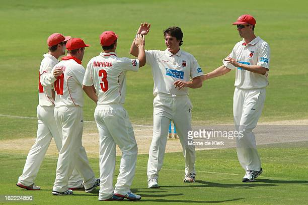 Daniel Worrall of the Redbacks celebrates with teammates after he got a wicket during day three of the Sheffield Shield match between the South...