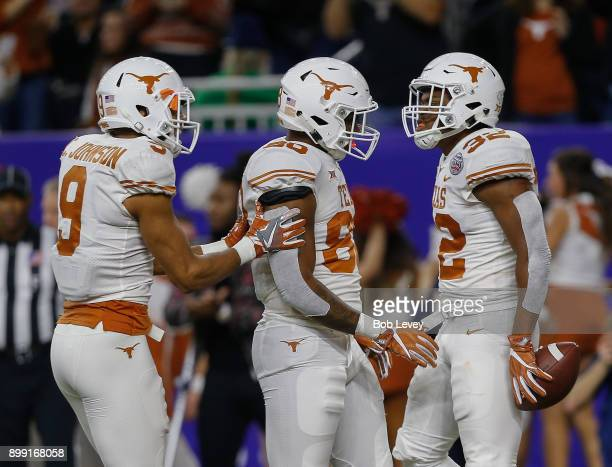 Daniel Young of the Texas Longhorns celebrates with Cade Brewer and Collin Johnson after scoring against the Missouri Tigers during the Academy...