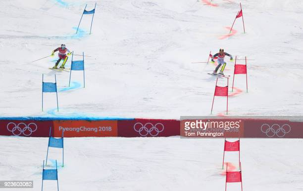 Daniel Yule of Switzerland and Linus Strasser of Germany compete during the Alpine Team Event Quarterfinals on day 15 of the PyeongChang 2018 Winter...