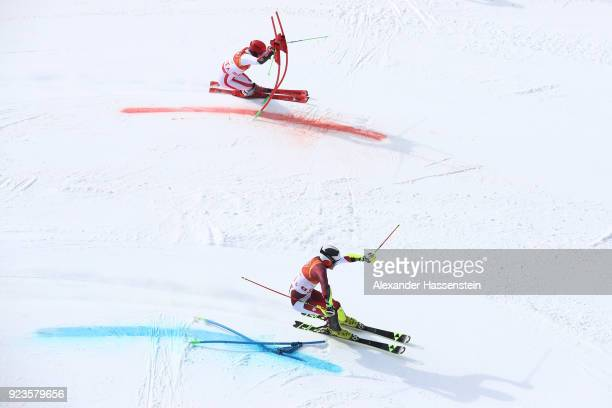 Daniel Yule of Switzerland and Marco Schwarz of Austria compete during the Alpine Team Event Big Final on day 15 of the PyeongChang 2018 Winter...