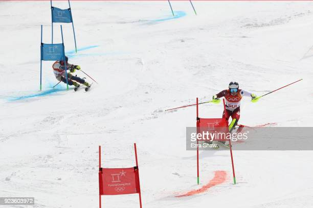 Daniel Yule of Switzerland and Marton Kekesi of Hungary compete during the Alpine Team Event 1/8 Finals on day 15 of the PyeongChang 2018 Winter...