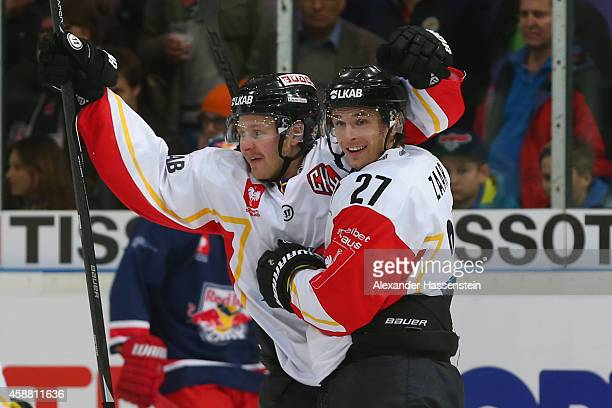 Daniel Zaar of Lulea celebrates scoring the 6th team goal with his team mate Lucas Wallmark during the Champions Hockey League PlayOff Round of 16...