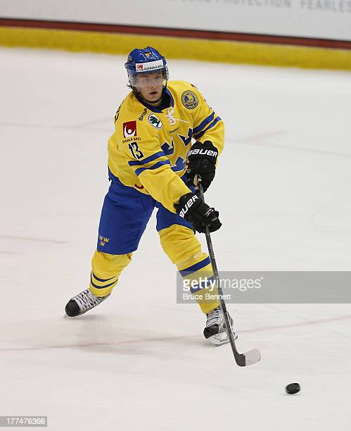 Daniel Zaar of Team Sweden skates against Team USA during the 2013 USA Hockey Junior Evaluation Camp at the Lake Placid Olympic Center on August 7...