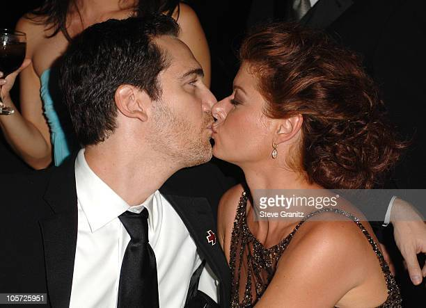 Daniel Zelman and Debra Messing during The 57th Annual Emmy Awards Governors Ball at Shrine Auditorium in Los Angeles California United States