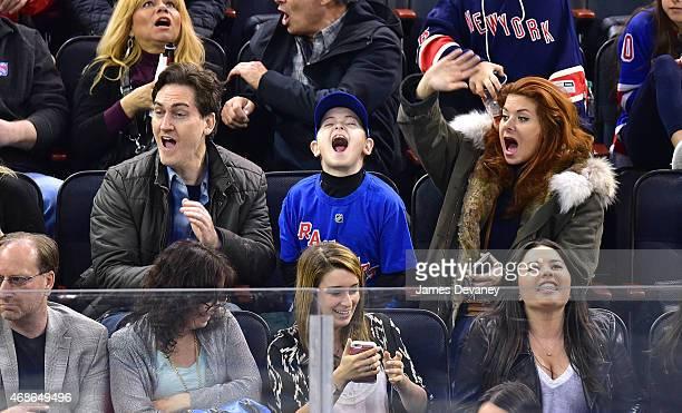 Daniel Zelman Roman Zelman and Debra Messing attend New Jersey Devils vs New York Rangers game at Madison Square Garden on April 4 2015 in New York...