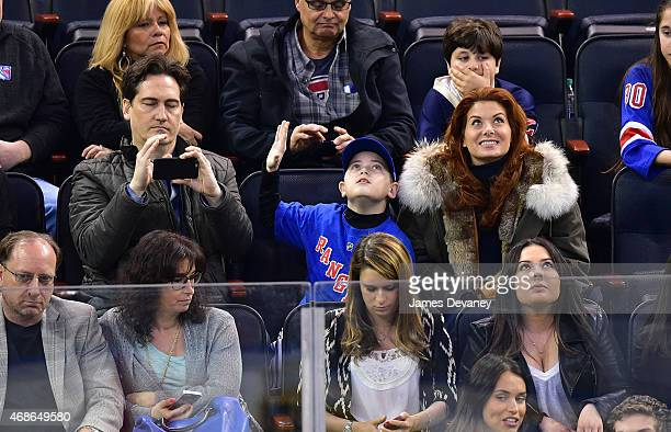 Daniel Zelman Roman Zelman and Debra Messing attend New Jersey Devils vs New York Rangers game at Madison Square Garden on April 4 2015 in New York...
