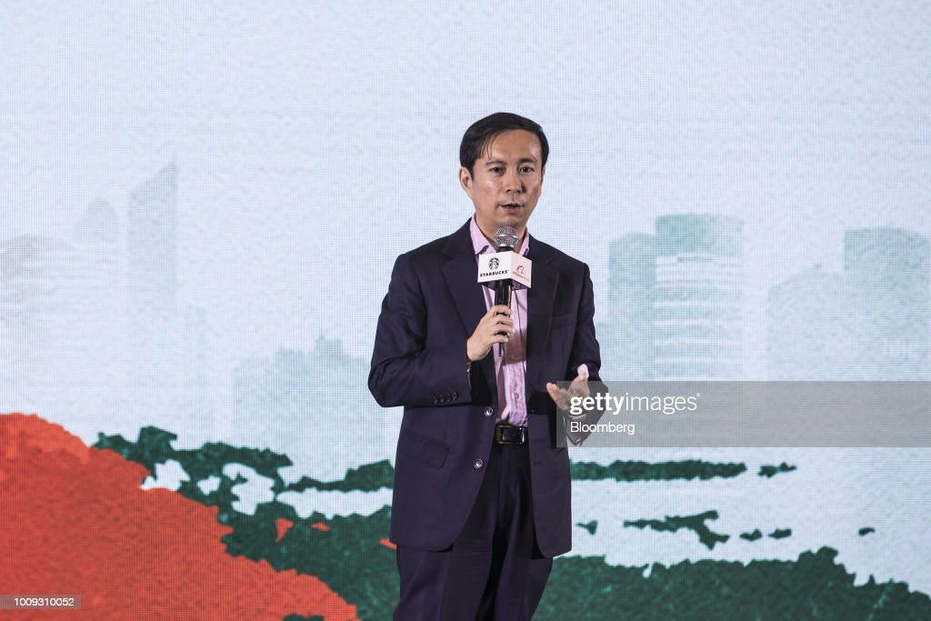 Daniel Zhang, chief executive officer of Alibaba Group Holding Ltd., speaks during a news conference in Shanghai, China, on Thursday, Aug. 2, 2018. Starbucks Corp. is joining forces with Alibaba to begin delivering its drinks and baked goods in China, rolling out an effort to stave off competitors and turn around sales in the country. Photographer: Qilai Shen/Bloomberg via Getty Images