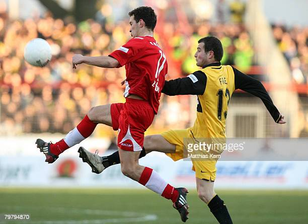 Daniel Ziebig of Cottbus battles for the ball with Alexander Frei of Dortmund during the Bundesliga match between FC Energie Cottbus and Borussia...