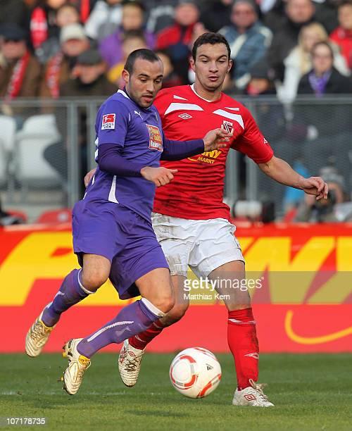 Daniel Ziebig of Cottbus battles for the ball with Fabian Mueller of Aue during the Second Bundesliga match between FC Energie Cottbus and Erzgebirge...