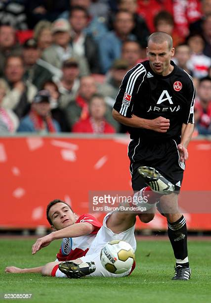 Daniel Ziebig of Cottbus challenges Peer Kluge of Nuernberg during the Bundesliga Play Off match between FC Energie Cottbus and 1.FC Nuernberg at the...