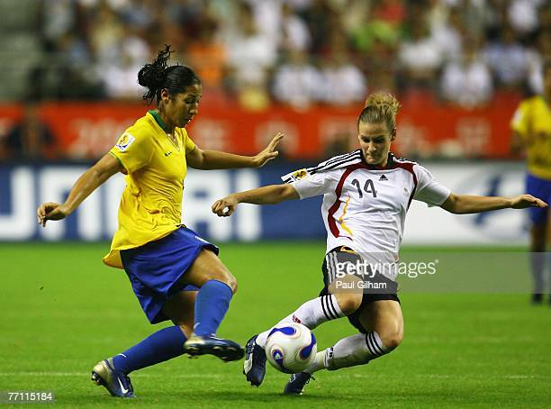 Daniela Alves Lima of Brazil battles for the ball with Simone Laudehr of Germany during the Women's World Cup 2007 Final between Brazil and Germany...