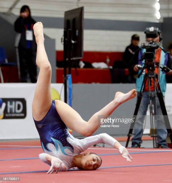 Daniela Amendola of Argentina falls during the Floor event in the Women's Team allaround as part of the I ODESUR South American Youth Games at...