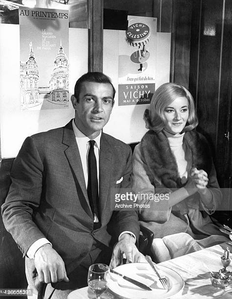 Daniela Bianchi and Sean Connery sitting at a dining table together in a scene from the film 'James Bond From Russia With Love' 1963