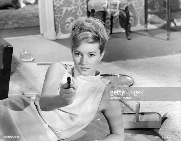 Daniela Bianchi lying on her side pointing a gun in a scene from the film 'James Bond From Russia With Love' 1963