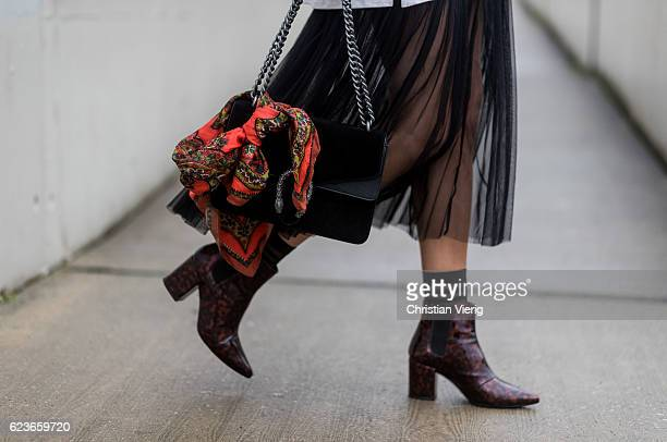 Daniela Breithaupt wearing a black sheer dress Zara white sweater Vintage heeled chelsea boots Zara socks Primark sunglasses Zaful black Gucci bag on...